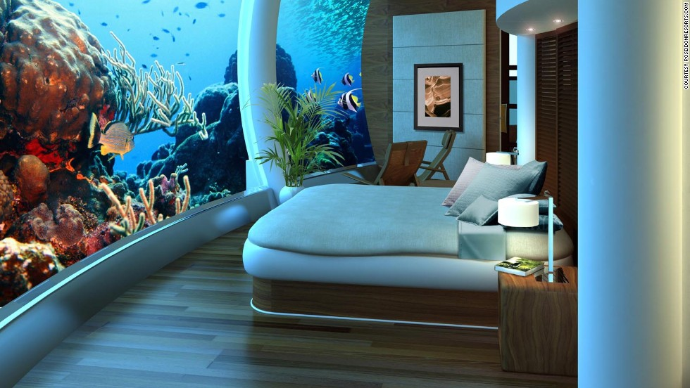 Guests here are invited to interact with the surroundings -- at the push of a button the fish are fed, and the flip of a switch turns on sparkling underwater lights.