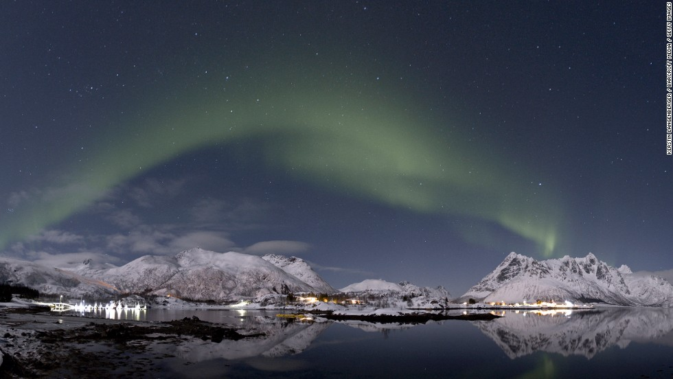 The aurora borealis lights up the night sky in Lofoten, Norway. The spectacular shows occur when charged particles from the solar wind interact with the Earth's atmosphere at the magnetic poles.