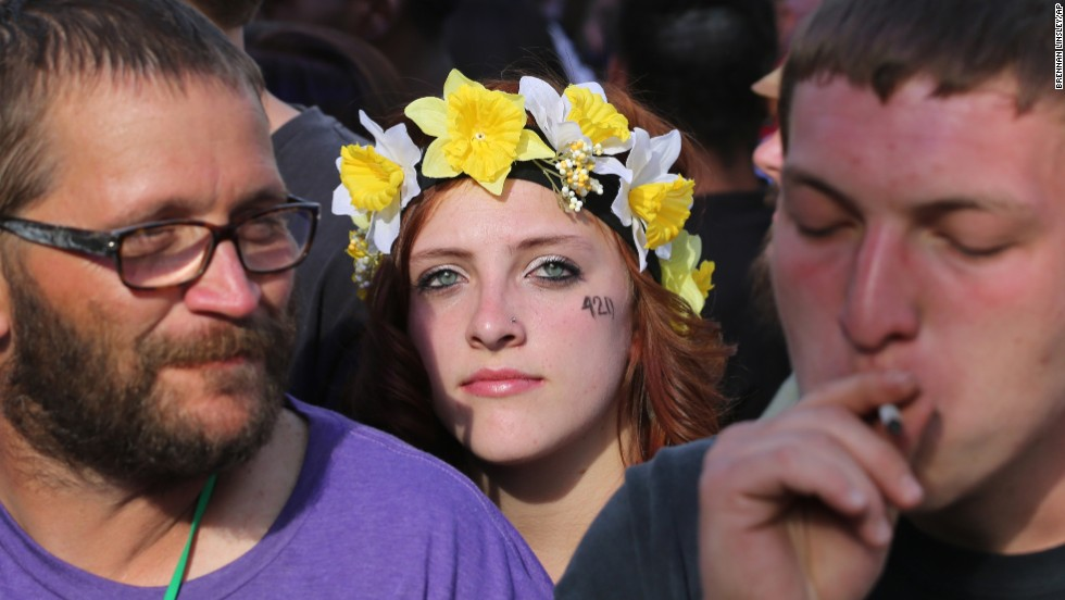 Partygoers listen to live music and smoke pot at Denver's 420 Rally on April 20.