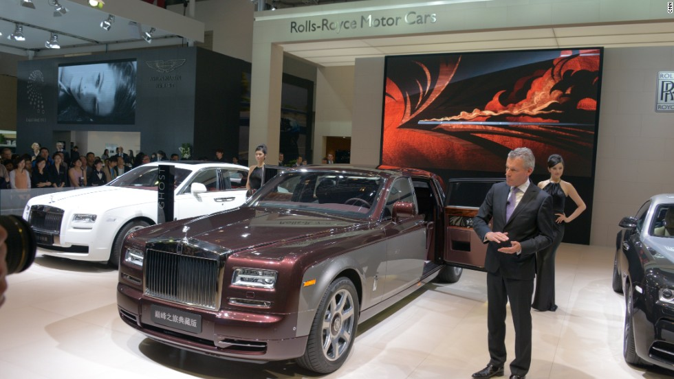 Rolls-Royce CEO Torsten Muller-Otvos unveils the Pinnacle Travel Phantom in Beijng. The car has many bespoke touches that appeal to the super-rich, starting with a two-tone exterior.