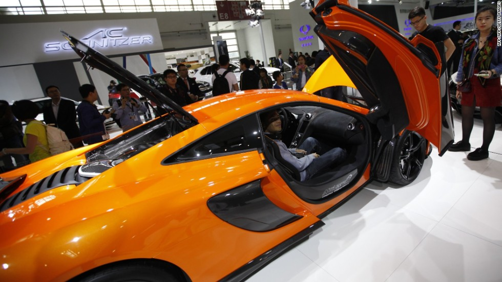 Many brands went all-out to attract media attention. Infiniti invited Hong Kong pop star GEM to promote their cars, while Hyundai snagged South Korean actor Kim Soo Hyun, who has a lot of fans in China. This image show a McLaren car on display at Beijing Auto Show.