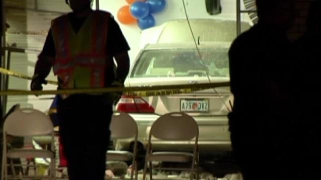 Car crashes into church during service