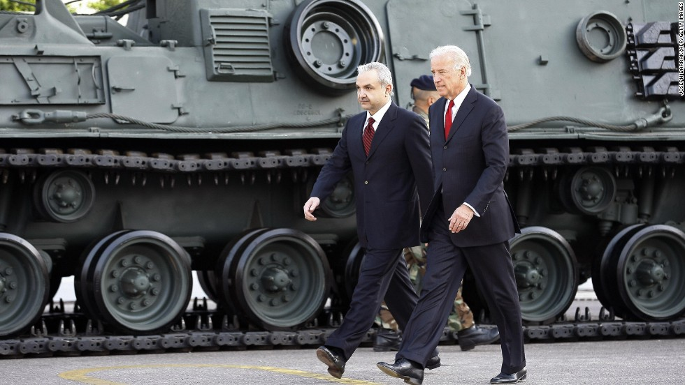 Biden and Lebanese Defense Minister Elias Murr walk past a U.S.-made tank during a ceremony at the Rafiq Hariri International Airport in Beirut on May 22, 2009.