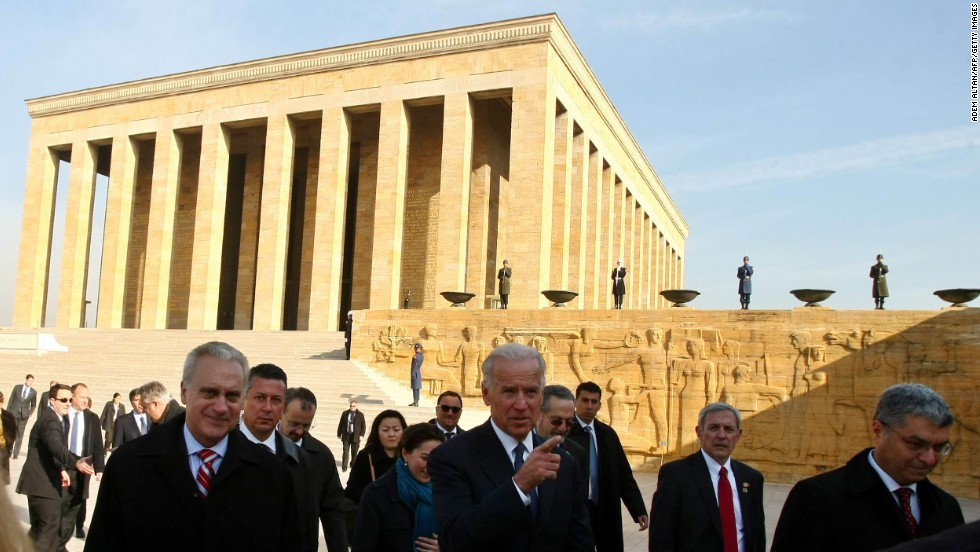 Biden is surrounded by security agents and Turkish officials during a wreath-laying ceremony at the mausoleum of Kemal Ataturk, the founder of modern Turkey, in Ankara on December 2, 2011.