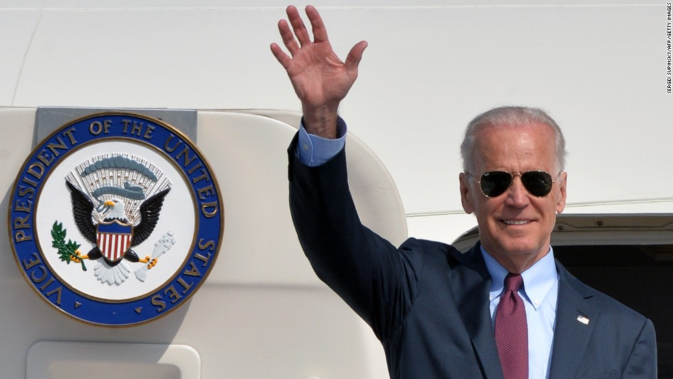 Vice President Joe Biden waves after landing in Kiev on April 21, 2014. He was dispatched there to show U.S. solidarity with the Ukrainian government in its conflict with Russia. Biden was a frequent flier long before he became vice president. Click through the images to see some of his travels.