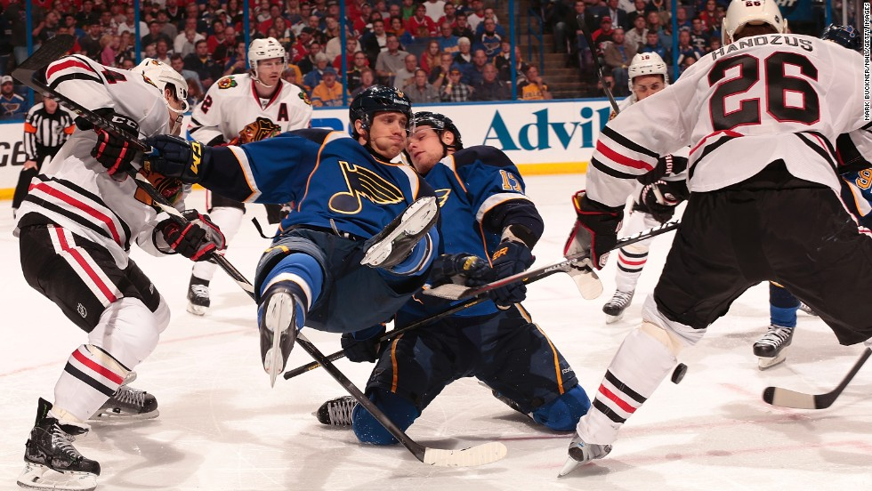 No. 9, Jaden Schwartz of the St. Louis Blues, falls to the ice after a face off against the Chicago Blackhawks in the first round of the 2014 Stanley Cup Playoffs on April 19 in St. Louis.