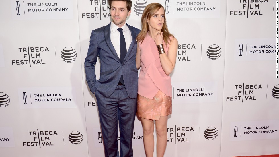 "Actors Roberto Aguire and Emma Watson soak in the premiere of ""Boulevard"" at the Tribeca Film Festival on April 20."