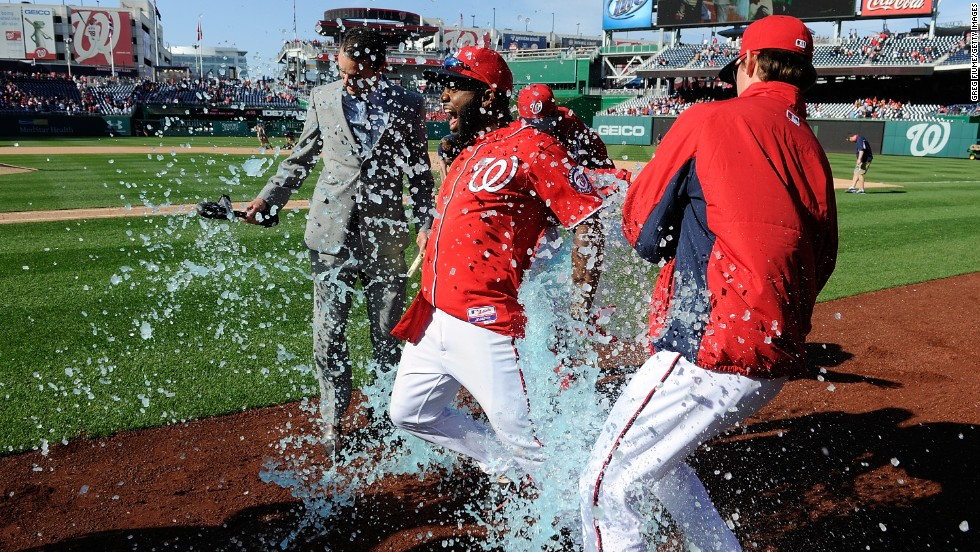Outfielder Denard Span of the Washington Nationals is doused with Gatorade by Drew Storen and Tyler Clippard after driving in the game-winning run in the ninth inning against the St. Louis Cardinals on April 20 in Washington. The Nationals won the game 3-2.