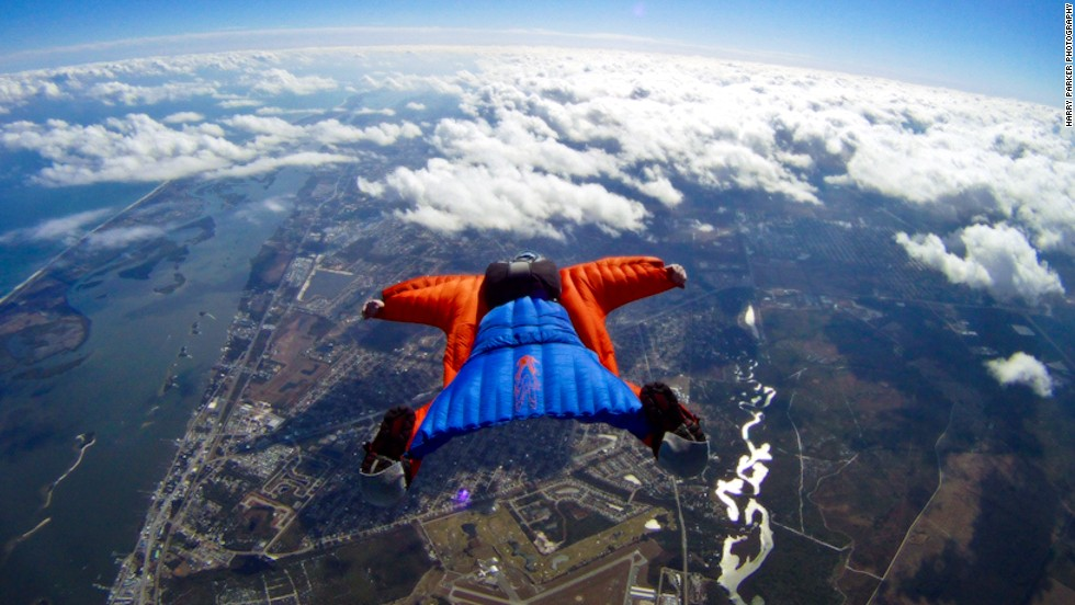 "<em>Is it a bird? Is it a plane? Actually, it's a bit of both. </em><br /> <br />Wingsuits fly for the same reason jets take off and eagles soar.<br /> <br />The suits turn the human body into an ""airfoil"" -- a curved wing that produces lift by allowing air to flow faster over the wing than under it.<br /> <br />Skydiving photographer <a href=""http://www.theharryparker.com/"" target=""_blank"">Harry Parker</a> caught these incredible images of wingsuiter Rip Cord in action over Sebastian, Florida. And we asked skydiving pioneer Tony Uragallo, founder of <a href=""http://www.tonywingsuits.com/index.html"" target=""_blank"">TonySuits</a>, to tell us more about how today's wingsuits fly.<br /><br /><em>[All photos: Courtesy </em><em><a href=""http://www.theharryparker.com/"" target=""_blank"">Harry Parker Photography<em></em></a>]</em>"