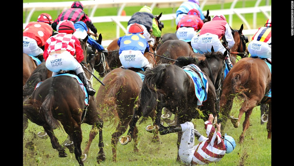 Vlad Duric falls off Golfing in in the home straight during Melbourne Racing at Caulfield Racecourse on April 19 in Melbourne. Duric suffered a minor leg injury.