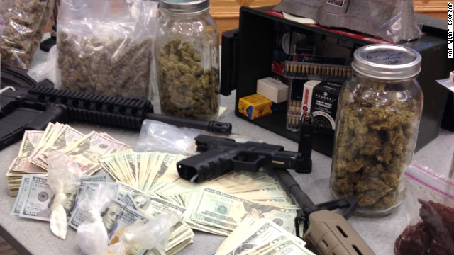 Authorities seized stacks of cash and some semi-automatic weapons