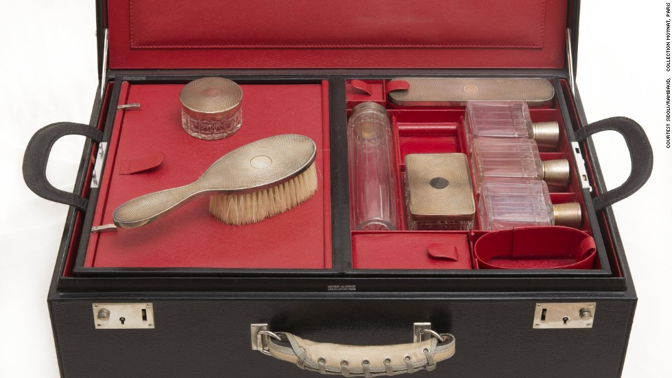 Exhibition curator Claude Mollard says that he wants visitors to imagine that the train has stopped at a station, and the passengers have stepped out leaving their possessions, such as this elegant toiletry case, inside.