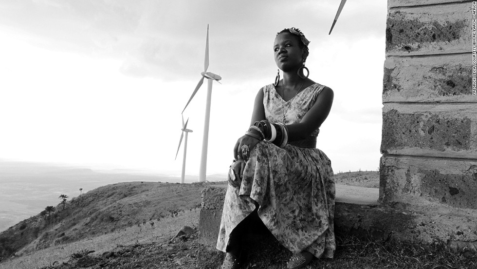 In this image, a young woman sits near the turbines in the Ngong region of Kenya. Renewable energy sources have huge potential in Africa as it seeks to address its electricity shortage.