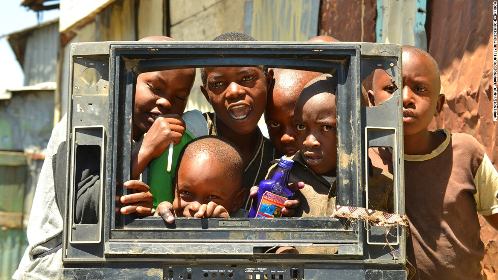 "Entrants to IBM's The World Is Our Lab photo competition sent images highlighting Africa's biggest challenges and opportunities. Lawrence ""Shabu"" Mwangi won with an image he took of children playing with the plastic frame of an old TV in the Mukuru slum in Nairobi."