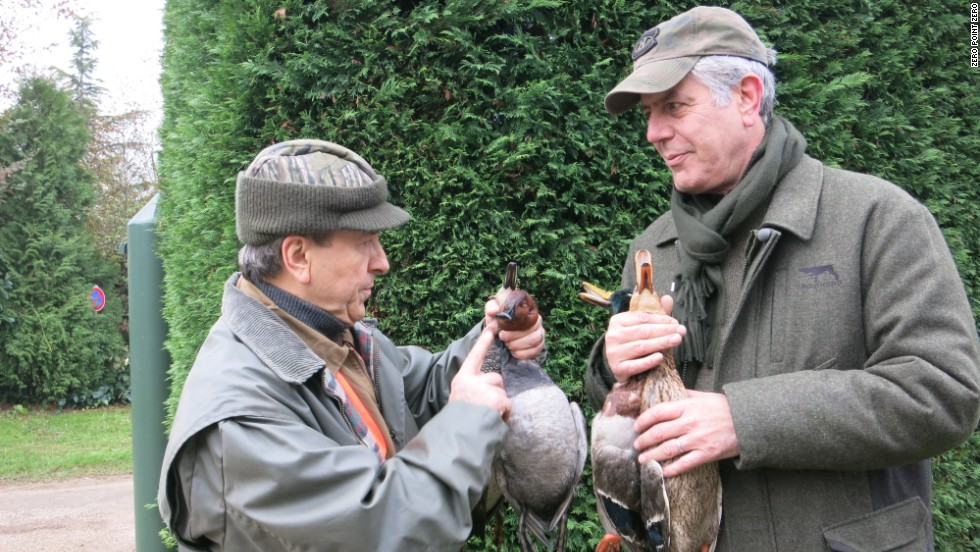 Boulud, left, and Bourdain with the birds from their duck hunt.