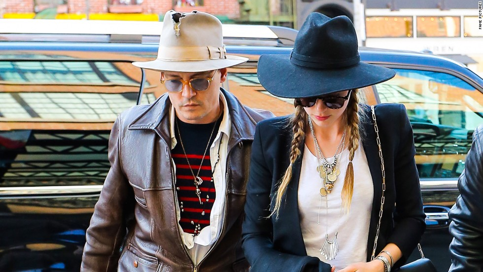Johnny Depp and his fiancee Amber Heard wear nearly matching hats on April 21.