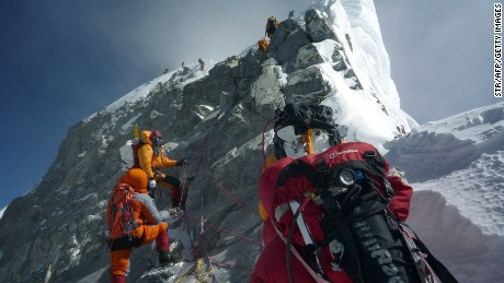 Mountaineers walk past the Hillary Step while pushing for the summit of Mount Everest as they climb the south face from Nepal, May 19, 2009.