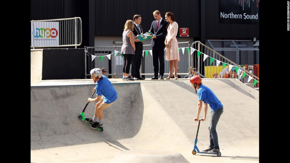 The royal couple is given a skateboard by city of Playford Mayor Glenn Docherty, second left, during a display at a skate park in the Adelaide suburb of Elizabeth on April 23.