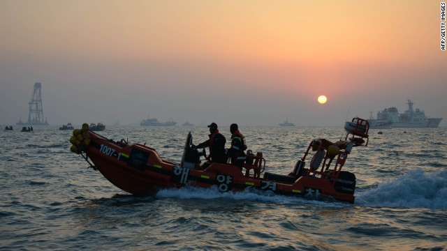 Coatguard boats and search and rescue teams take part in recovery operations at the site of the 'Sewol' ferry of the coast of the South Korean island on Jindo on April 22, 2014.