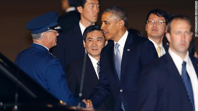 U.S. President Barack Obama arrives Wednesday at Haneda International Airport in Tokyo.