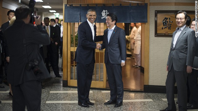 "President Obama, left, shakes hands with Japanese Prime Minister Shinzo Abe before a private dinner at Sukiyabashi Jiro restaurant in Tokyo on April 23.  Obama landed in Tokyo on April 23 to launch an Asian tour dedicated to reinvigorating his policy of ""rebalancing"" US foreign policy towards a dynamic Asia. Sukiyabashi Jiro's less-than-plush surroundings notwithstanding, it is the proud possessor of three Michelin stars, and people flock to pay a minimum $300 for 20 pieces of sushi chosen by the 88-year-old patron, Jiro Ono."