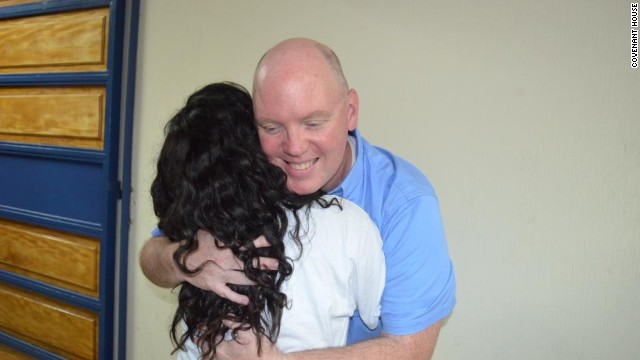 Covenant House CEO Kevin Ryan hugs a resident.