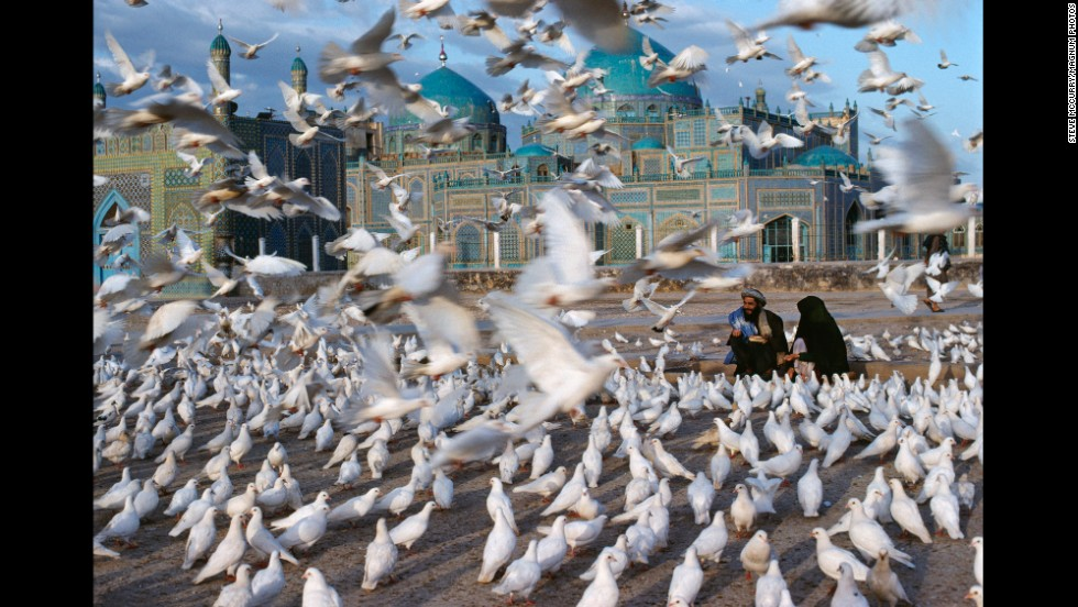 "Doves fly in front of the Blue Mosque in Mazar-i-Sharif, 1992. <a href=""http://cnnphotos.blogs.cnn.com/2012/10/27/curiosity-inspires-iconic-photographer/"">See what inspires iconic photographer Steve McCurry.</a>"