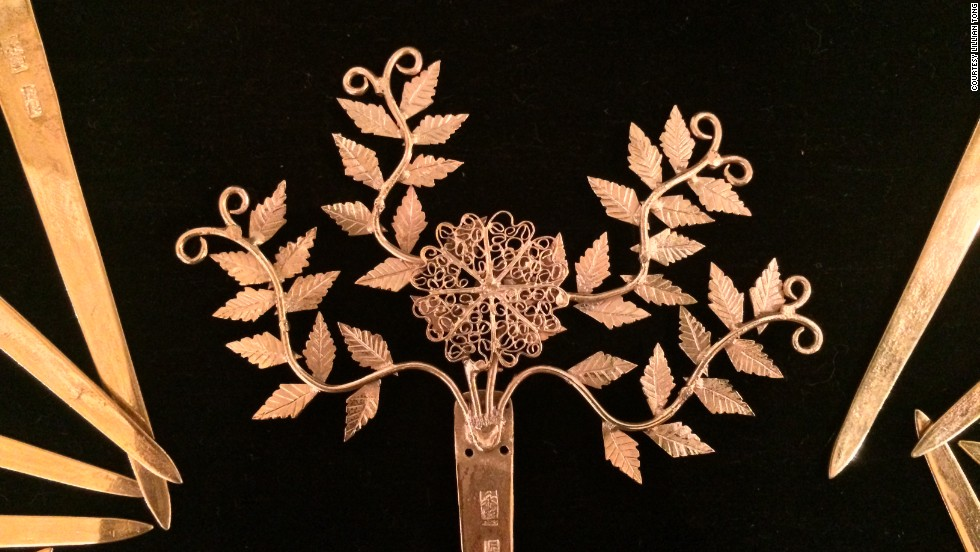 Wealthy merchants favored a sophisticated style, and appreciated the mastery of craftsmanship, such as this filigree of ferns, as much as the value of gems and gold on display.