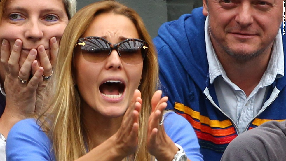 Ristic strikes a typical pose as she supports Djokovic during a match at Wimbledon.