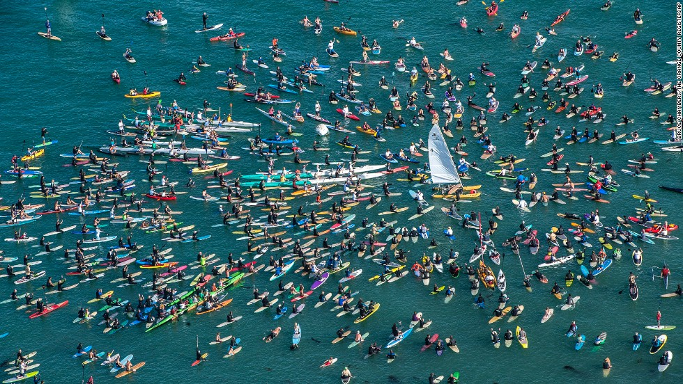 "Surfers and rowers gather around a Hobie Cat catamaran off Doheny State Beach in Dana Point, California, on Friday, April 18, to<a href=""http://money.cnn.com/2014/01/16/leadership/hobie-surfboards.pr.fortune/""> celebrate the life of surf and sailing entrepreneur Hobie Alter</a>. Hobie died on March 29 at his California home after a lengthy battle with cancer. He was 80."