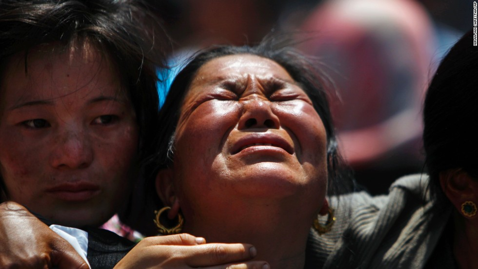 "Relatives of mountaineers killed in an avalanche on Mount Everest cry during the funeral ceremony in Katmandu, Nepal, on Monday, April 21. A high-altitude avalanche killed 13 Sherpa guides on Friday in the single deadliest accident on Mount Everest. Three more Sherpas are missing and feared dead. A Buddhist clergy <a href=""http://www.cnn.com/2014/04/23/world/asia/nepal-everest-avalanche/index.html"">commended all 16 souls in a religious ceremony</a>."