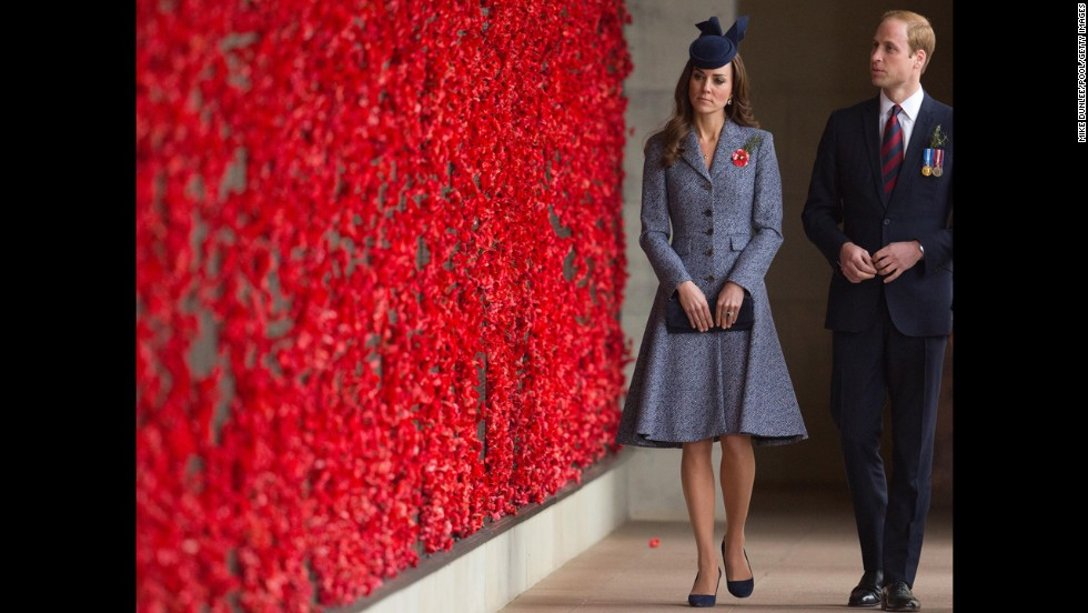 The royal couple walk along the World War I Wall of Remembrance during their visit to the Australian War Memorial.