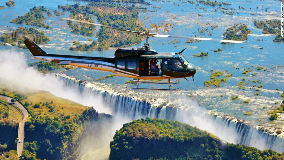 With fully open side doors, the 13-passenger Huey zigzags above the Zambezi River before rapidly rising up and over Victoria Falls.