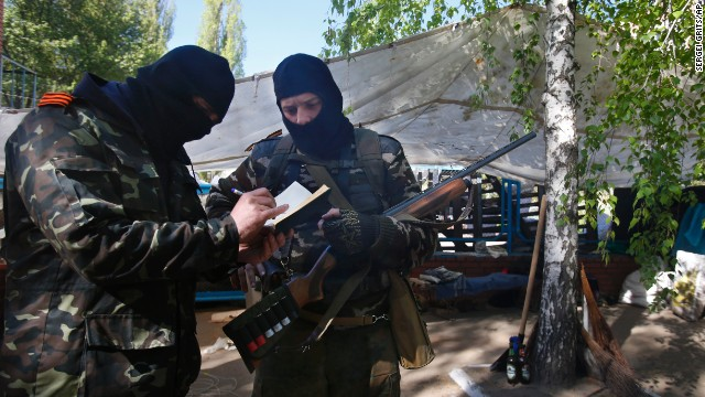 Pro Russian militants keep records of their duty at the barricades in Slovyansk , eastern Ukraine, April 25.