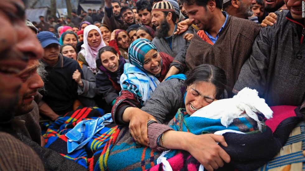 Sumaira Wani, wife of Zia-Ul-Haq, mourns by the body of her husband during his funeral in Hirpora, some 65 kilometers (40 miles) north of Srinagar on Friday, April 25. Zia, an Indian poll official, was killed soon after voting in the ongoing election, when suspected rebels fatally shot him and wounded four others in an attack on a bus in the Indian-controlled portion of Kashmir.