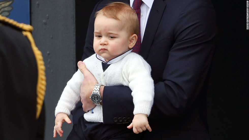 Prince George doesn't look so pleased on the tarmac as the British royals leave the Wellington airport.