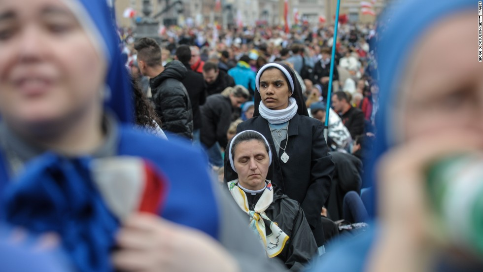 A group of nuns attends the canonization of Popes John Paul II and John XXIII.