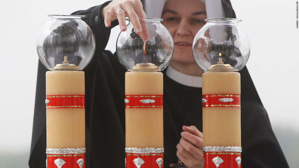 Sister Sancja readies the altar in God's Mercy sanctuary in Krakow, Poland, on April 27, for ceremonies celebrating the canonization of Polish-born Pope John Paul II.