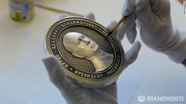 "A new coin commemorates Russia's ""reunification"" with Crimea -- but at what cost to the economy?"
