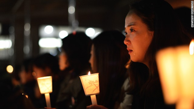 Friends, relatives and neighbors gather for a candlelight vigil at Danwon High School on April 18, 2014 in Ansan, South Korea.