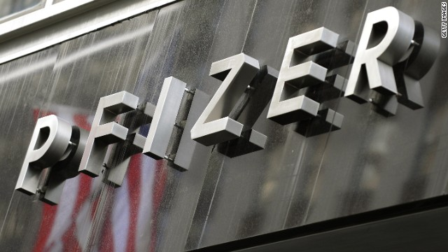A sign for pharmaceutical company Pfizer Incorporated headquarters is displayed on 42 Street in New York October 20, 2009. US pharmaceutical giant Pfizer January 28, 2014 reported a big drop in quarterly profits, but bested analyst expectations and pointed to several new drugs in development. Pfizer, which has been bruised in recent quarters by patent expirations on some blockbuster drugs, said fourth-quarter profits fell nearly 60 percent due mainly to an asset sale in the year-ago period. However, fourth-quarter operating income in 2013 rose compared with the year-ago period.