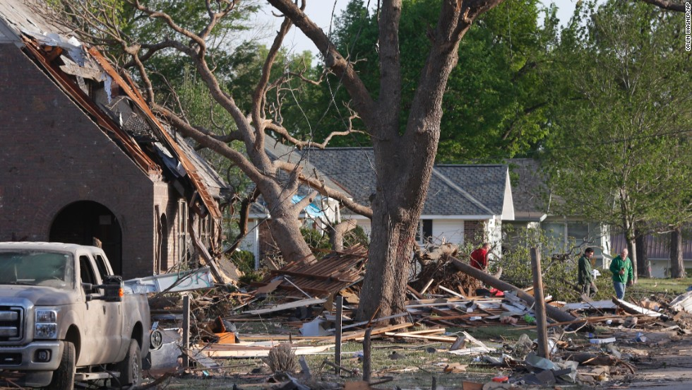Residents of Baxter Springs, Kansas, view damage on April 28. A tornado estimated to be three blocks wide rumbled through Baxter Springs, said Cherokee County emergency manager Jason Allison.