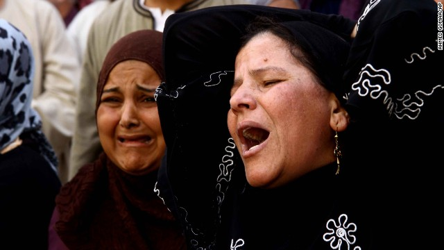 Egyptian women weep after a judge sentenced to death more than 680 alleged supporters of the country's ousted Islamist president in a mass trial in Minya, Egypt, Monday, April 28, 2014.