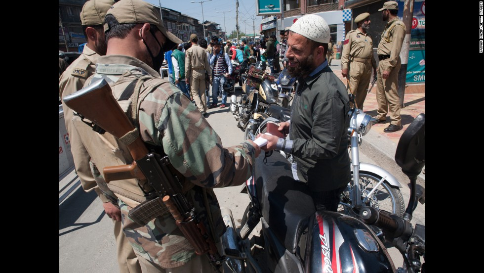 Police conduct a security check Monday, April 28, before voting in Srinagar.