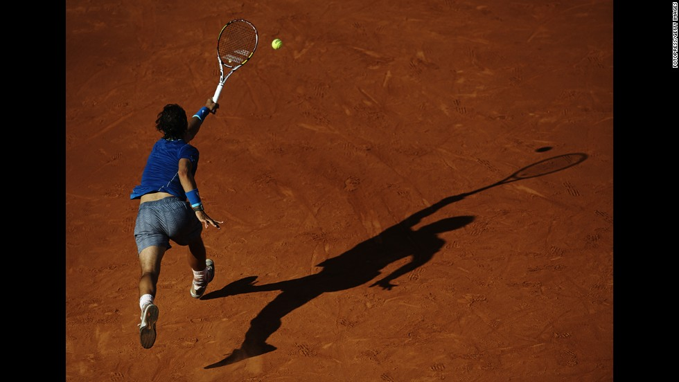 Rafael Nadal reaches for a shot on Friday, April 25, during a quarterfinal match at the Barcelona Open in Barcelona, Spain. Nicolas Almagro upset Nadal in three sets, ending Nadal's 41-match winning streak at the event.