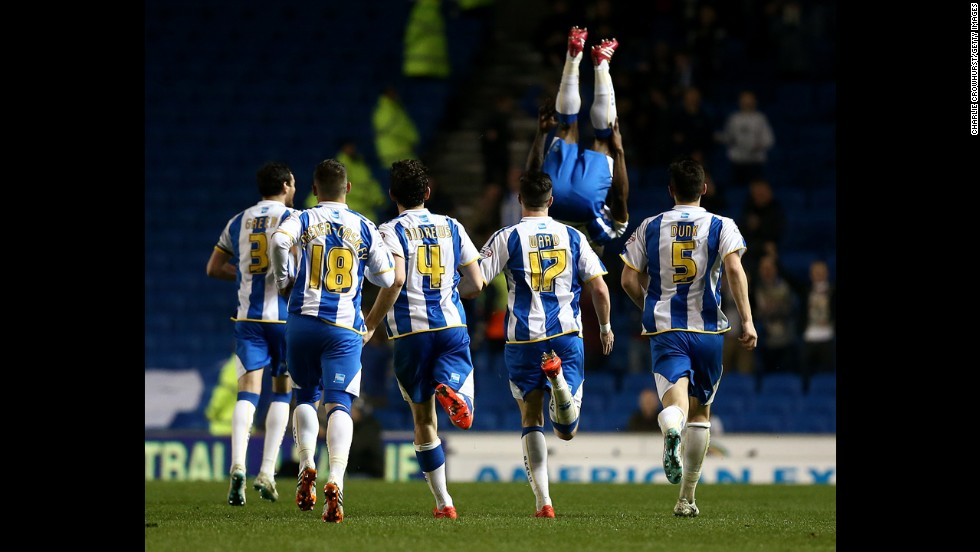 Kazenga Lua Lua flips in the air after scoring a goal for Brighton & Hove Albion during their 2-0 win against Yeovil Town on Friday, April 25, in Brighton, England. The teams play in the Championship, the second-highest division of English soccer.