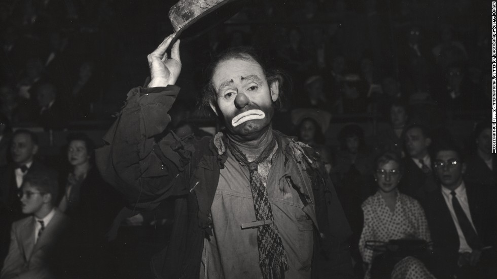 "American circus performer Emmett Kelly Sr. lifts his hat at the circus in 1943. His character Weary Willie, a sad and tattered tramp, is one of the best-known clowns of the Ringling Bros. and Barnum & Bailey combined circus. He joined the Ringling Bros. circus in 1942 and stayed with it until the late 1950s. In 1952, he made his motion-picture debut in ""The Greatest Show on Earth"" with Charlton Heston and James Stewart."