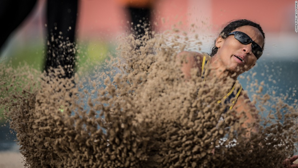 Silvania Costa de Oliveira, a paralympic athlete from Brazil, competes in the long jump during the T11 event at the Loterias Caixa Brazilian Athletics Open Championships on Friday, April 25. The T11 category is for athletes who are visually impaired.