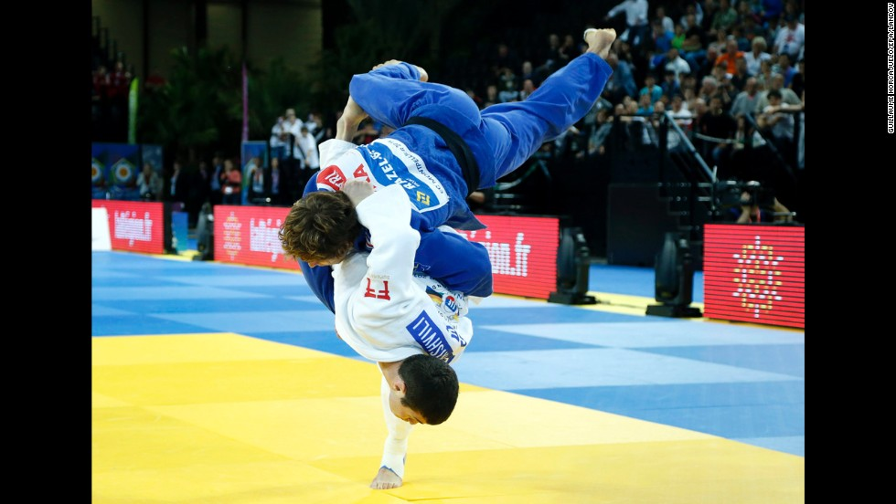 Avtandil Tchrikishvili of Georgia, bottom, competes against Loic Pietri of France at the European Judo Championships in Montpellier, France, on Friday, April 25. Tchrikishvili won the match, which was the final in the 81-kilogram category (nearly 179 pounds).