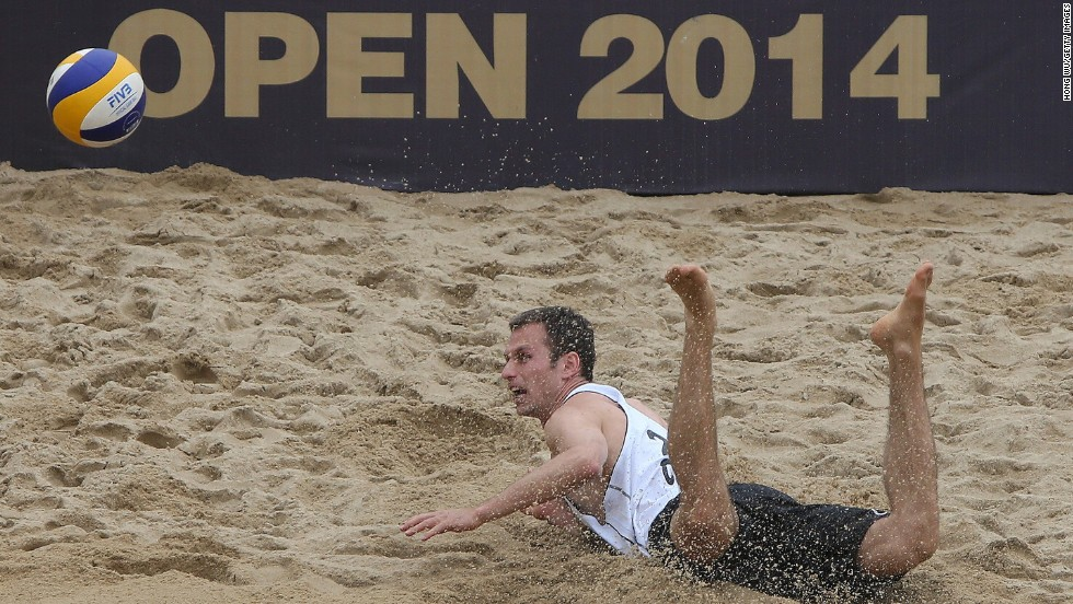 Beach volleyball player Jan Dumek dives to the ground during a match Wednesday, April 23, at the Fuzhou Open in Fuzhou, China.